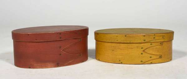 "Two 19th C. Shaker finger boxes, oval, yellow example 6.25"" L and red 6"" L. Condition: structurally good, paint later"