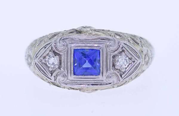Art Deco Diamond and Sapphire ring. 18kt white gold filigree dome top ring set with a French cut pretty light cornflower blue sapphire (possibly Montana), approx. .20 ct., accented by approx. .06 ct. tw. round brilliant cut diamonds, sz. 6 1/4, 3.7 grams.  Condition good New bidders to Smith's, payment for this lot must be made with cash, bank approved check or wire transfer. NO CREDIT CARDS accepted as payment for this lot.