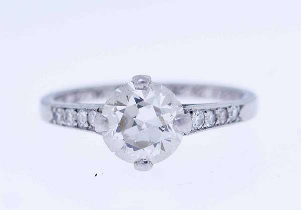 Tiffany & Co. diamond solitaire engagement ring, approx. 1.5 ct., I/J VS transitional cut, set in iridium platinum, accented by approx. .21 ct. tw. round brilliant cut diamonds, sz. 6 3/4, 3.5 grams (inscription W.D.W. to M.L.C. 1929).  Condition: small chips to outer edge of diamond.   New bidders to Smith's,  payment for this lot must be made with cash, approved bank check or wire transfer. NO CREDIT CARDS accepted as payment for this lot.