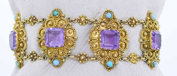 Antique 14k yellow gold cannetille amethyst bracelet,  accented with turquoise cabochons and approx. 1.0 ct. tw. oval aquamarine, approx. 15 ct. tw. square emerald cut amethyst, 29 mm wide, (tested 14kt) 21.6 grams. Condition; one oval aqua is chipped, slight abrasions to amethyst will polish out.  New bidders to Smith's - payment for this lot must be made with cash, approved bank check or wire transfer. NO CREDIT CARDS accepted as payment for this lot.