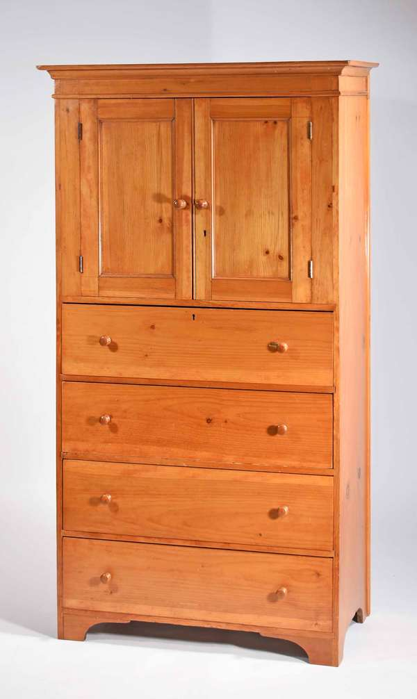 """19th C. Shaker pine floor cupboard, narrow size 2 panel doors above 4 drawers with an arched apron, nice hand forged iron lock,  72""""H x 36.5""""W x 18""""D. Prov. Reinhold/ Tolman Estate. Condition: refinished, the top drawers proper left drawer pull has chip in wood to drawer front, other nicks and abrasions."""