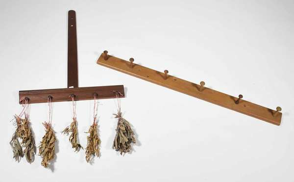 """19th C. walnut herb drying rack with 5 turned wood pegs 25.5""""H x 19""""W, and a pine peg rack 36""""L x 3""""H, with 6 varying sized pegs approx 2.75""""L. Reinhold/Tolman estate. Condition: herb rack is good with no loss, peg rack is refinished with 2 slightly different shaped pegs."""