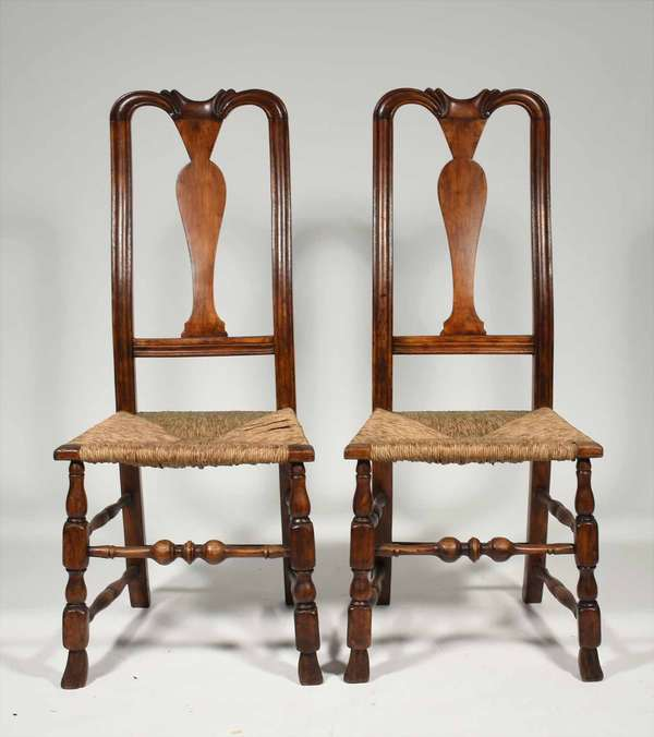 "Pair of 18th C. Queen Anne New England chairs, maple and pine with carved yoke crests, bulbous front stretcher and Spanish feet, 41"" back H x 17"" seat H x 18""W. Condition: old refinish, dish seat with wear as expected from 200 years of wear and respected use."