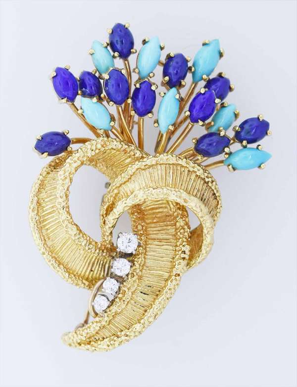18k gold diamond, turquoise and lapis brooch. A floral cornucopia form with a colorful spray of cabochon lapis and turquoise, accented by approx. .25 ct. tw. round brilliant cut diamonds, 2 1/8 in. long, 26.4 grams. Condition: good.  New bidders to Smith's - payment for this lot must be made with cash, bank approved check or wire transfer. NO CREDIT CARDS accepted as payment for this lot.