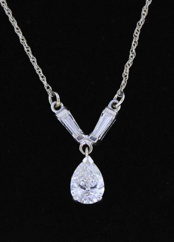 Lovely pear shaped Diamond pendant necklace, approx. .85 ct. H/I VS pear shaped diamond, accented by approx. .20 ct. tw. baguette diamonds, set in white gold, approx. 20 in. long., 2.4 grams. Condition very good.  New bidders to Smith's - payment for this lot must be made with cash, bank approved check or wire transfer.  NO CREDIT CARDS accepted as payment for this lot.