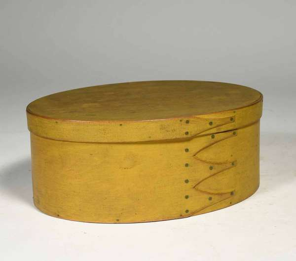 """19th C. Shaker finger box, oval with 4 fingers, painted yellow, 12""""L x 8.5""""D x 5"""" H. Condition: structurally sound."""