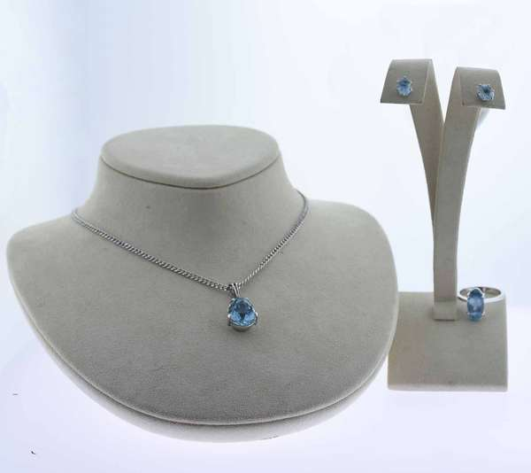 """Aquamarine set of a ring, earrings and pendant necklace: Necklace - 6 ct. pear shape medium blue aquamarine pendant on a 14.5"""" long 14k chain  Ring - 2.0 ct. oval medium blue aquamarine set  in 18k ring, sz. 6 1/2, Earrings - 1.0 ct.tw. light blue aquamarine stud earrings set in 14k  12.3 grams. Condition overall good, pendant and ring medium blue, earrings lighter blue. New bidders to Smith's - payment for this lot must be made with cash, bank approved check or wire transfer. NO CREDIT CARDS accepted as payment for this lot."""