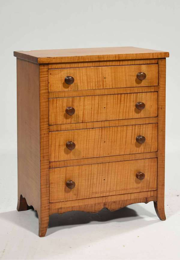 "A choice 19th C Federal child's size tiger maple chest,  with 4 dovetailed graduated drawers on French feet in good color, with history on underside of top drawer, 17""H x 13""W x 8.5""W. Condition: overall good, no damage or missing parts"