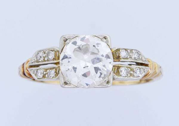 Vintage 1.1 ct Diamond ring, set in 14k yellow gold. Approx. 1.10 ct. (I-J, I1) transitional cut diamond, accented by .08 ct. tw. single cut diamonds, sz. 5 3/4, 2.1 grams. Condition: good New bidders to Smith's - payment for this lot must be made with cash, bank approved check or wire transfer. NO CREDIT CARDS accepted as payment for this lot.