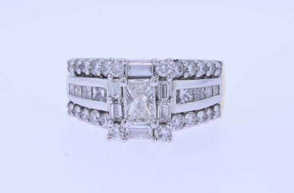 Lady's Diamond 18k gold ring, set with approx. .50 ct. radiant cut diamond center stone,  accented by approx. 1.50 ct. tw. round brilliant cut and baguette side diamonds, sz. 7 1/4, 11.8 grams. Condition: center stone I1 clarity others SI.  New bidders to Smith's - payment for this lot must be made with cash, bank approved check or wire transfer. NO CREDIT CARDS accepted as payment for this lot.