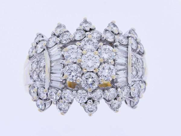Diamond cluster ring set in 18k yellow gold (tested) with approx. 2.0 ct. tw. (G-H-VS) round brilliant and baguette cut diamonds, sz. 8 1/4, 9.4 grams. Condition: very good. New bidders to Smith's - payment for this lot must be made with cash, bank approved check or wire transfer. NO CREDIT CARDS accepted as payment for this lot.