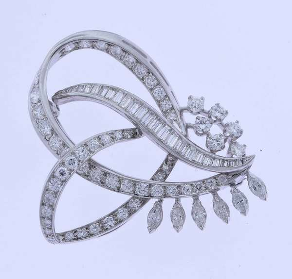 """3 ctw  Mid century design Diamond and platinum pin. Set with marquise, round brillian cut and baguette diamonds approx 3 ctw, VS, H-I color, 1.75""""L x 1.5"""" H, 12.5 grams. Condition: good, no loss or damage.  New bidders to Smith's - payment for this lot must be made with cash, bank approved check or wire transfer. NO CREDIT CARDS accepted as payment for this lot."""