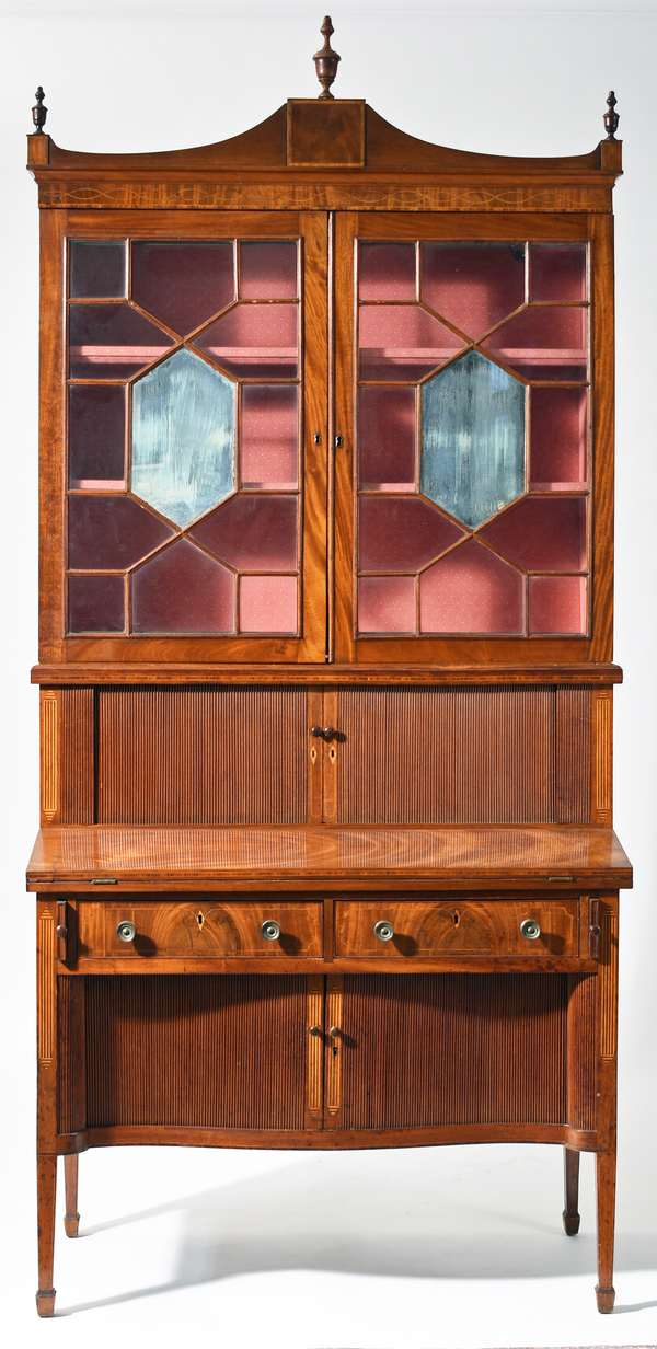 "Fine period Hepplewhite, two part inlaid MA secretary, ca 1800, with sectional mirrored and glass door top above tambour doors, revealing drawers and pigeon holes, fold out writing surface above 2 dovetailed drawers and serpentine tambour doors on spade feet. A unique architectural inlay found on Eastern MA examples, along with other inlays in rich mahogany wood, 82""H x 41""W upper case. The Museum of Fine Arts, Boston has in their collection a secretary with very similar architectural inlays attributed to work shop of Isaac Vose Boston. Condition: old pleasant refinish, old brass, some shrinkage cracks"
