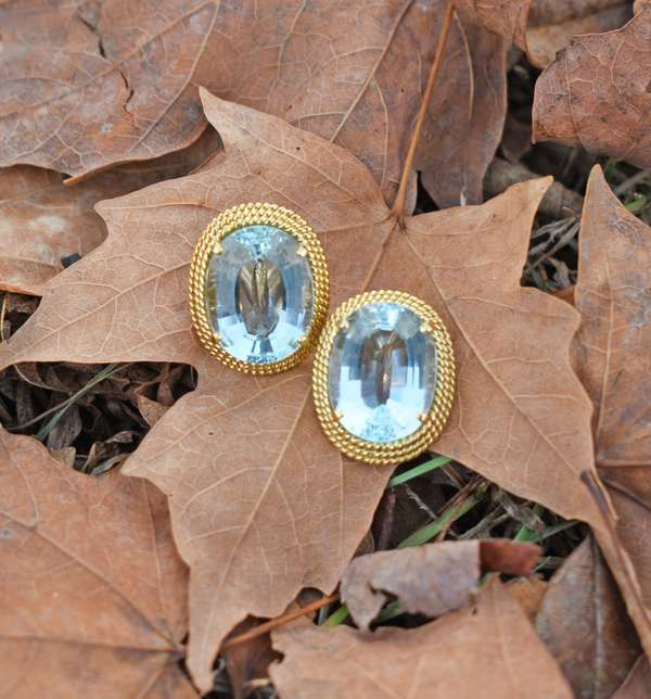 """20 ct. Aquamarine clip on earrings set in 18k yellow gold, each light to medium blue aquamarine is approx. 10 ct., approx. 7/8"""" H, 15.1 grams. Condition good, light to medium blue color aquas. New bidders to Smith's - payment for this lot must be made with cash, bank approved check or wire transfer. NO CREDIT CARDS accepted as payment for this lot."""
