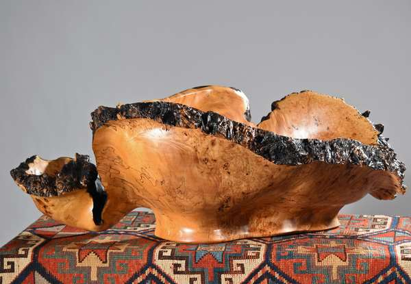"""An Incredible carved maple burl bowl by Etna, NH artist Dusty Coates. This is the best example of a burl wood carving we have ever seen. Dusty carved this as a commission for a special client and he called it 'The Chips & Dip Bowl'. It is a massive, one of a kind maple burl carving.   14""""H x 38""""L x 28""""D. Condition; excellent."""