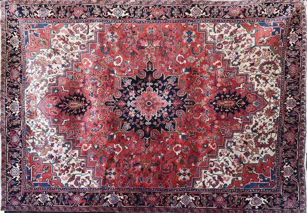 """Room size Oriental rug, Heriz with soft pastel colors and good full pile, 9'3"""" X 12'8"""". Condition: lustrous colors, full pile, good condition"""