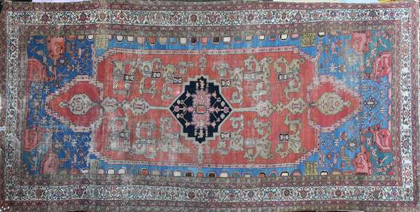 """Old room size Oriental rug, center medallion with four cartouches containing signatures, 8'6"""" X 15'9"""". Condition: estate found, rip in end border, area wear throughout, edge fraying/unraveling"""