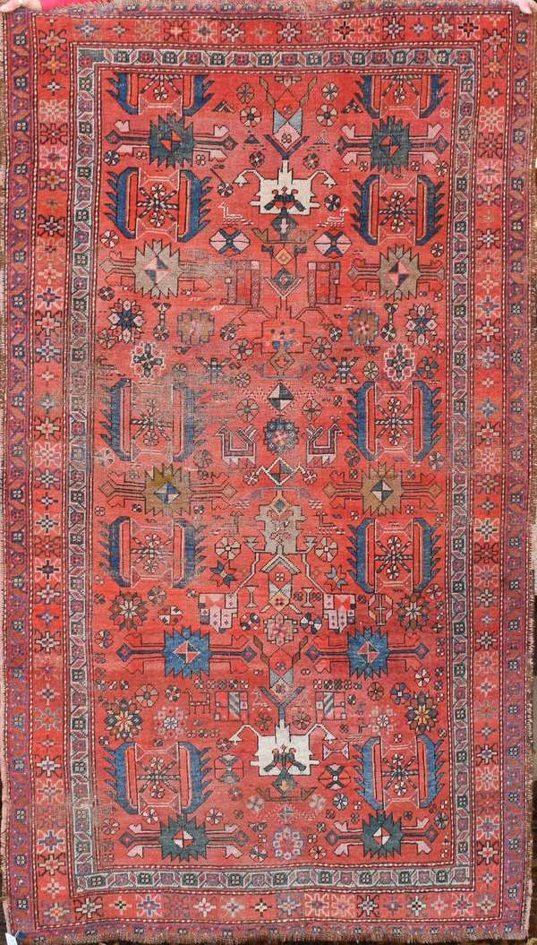 """Old Oriental scatter rug with geometric and floral motif, brick field, 4'1"""" X 7'1"""". Condition: area wear, some loss on end borders"""