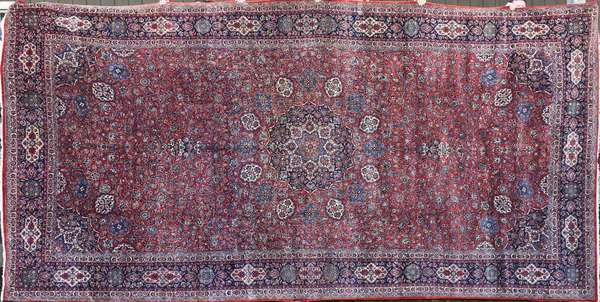Old room size Oriental rug, 10' X 20'. Condition: some area wear, overall good (306)