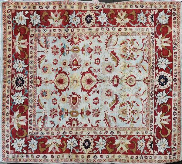 Room size Oriental rug, light blues and reds, 8' X 10'. Condition: overall good (304)