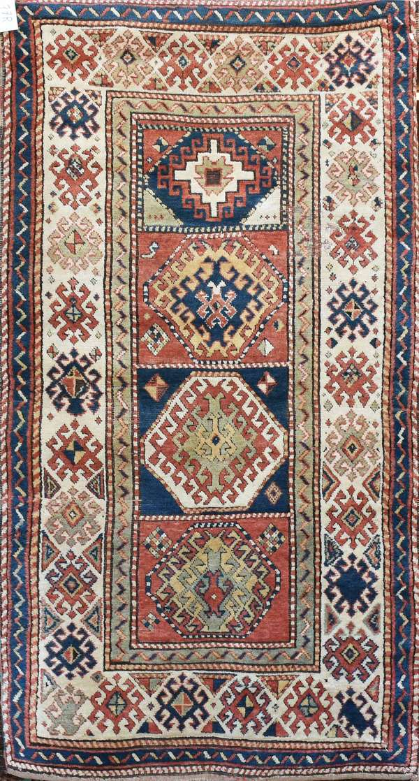 """Old Oriental scatter rug with four central geometrical medallions, multi-colored, 4' X 7'9"""". Condition: high pile with minor area wear, some edge fraying"""