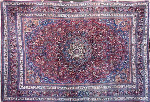 "Old room size Oriental rug with a central medallion surrounded by colorful floral Persian motifs, 9'2"" X 13'7"". Condition: area wear throughout rug, colors are vibrant"