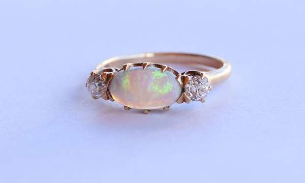 Antique Opal and Diamond ring,  set in 14kt yellow gold, approx. 1.0 ct oval opal cabochon (frosted), .35 ct. tw. Old European cut diamond sides, VS to SI dams., sz. 6 3/4, 3.1 grams.  Condition: good New bidders to Smith's, payment for this lot must be made with cash, bank approved check or wire transfer.  NO CREDIT CARDS accepted as payment for this lot.
