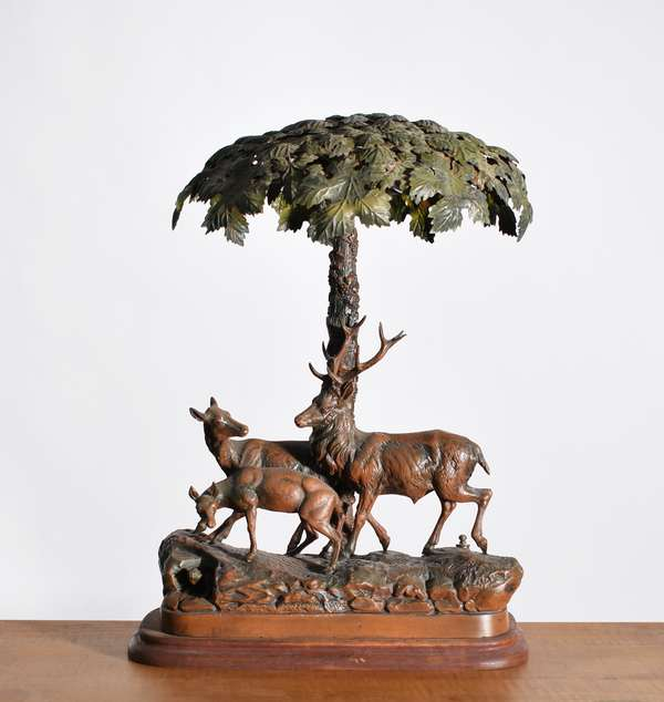 """Black Forest style Arts & Crafts painted metal table lamp, elk family under large tree, 20""""H. X 14""""W. X 13""""D. on wood base, Ca. 1930's. -Condition: minor paint flaking/abrasions"""