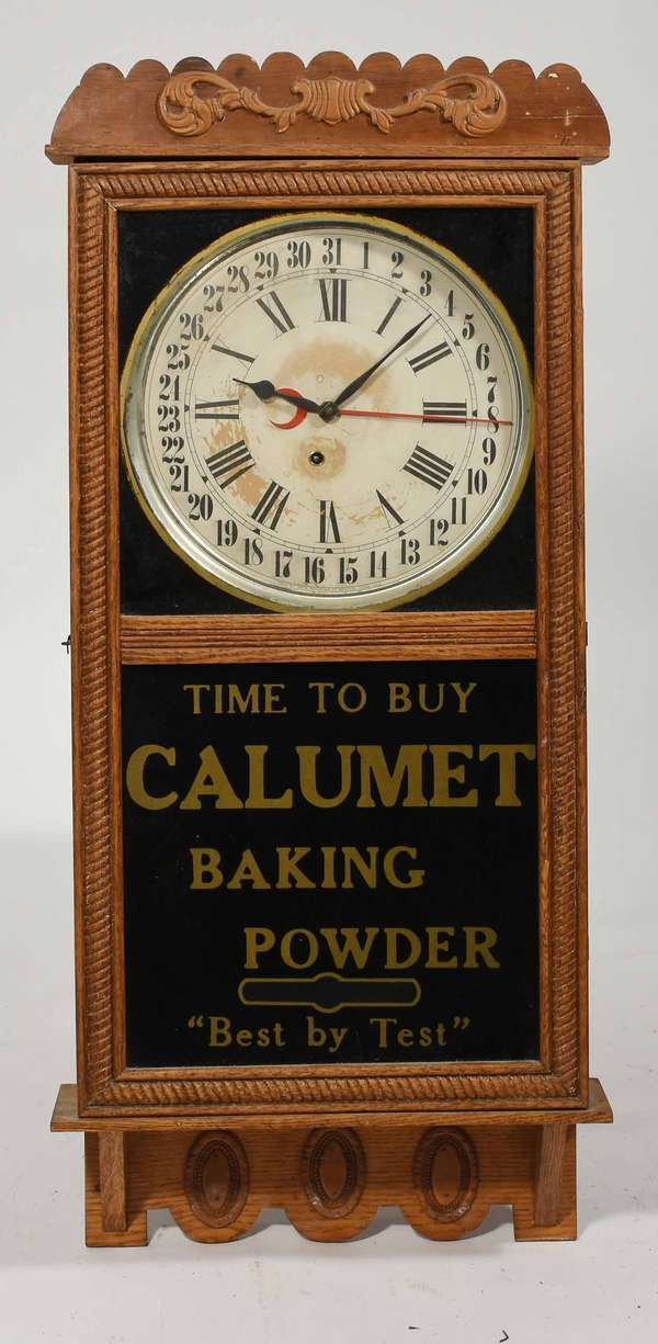 """Sessions oak advertising clock, Calumet Baking Powder, 39.5""""H. X 17""""W. -Condition: Cleaned surface with minor regluing and repairs, some loss to dial surface"""