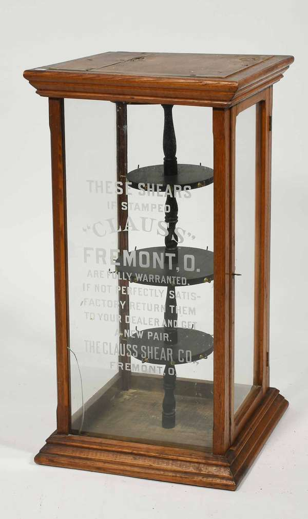 """Victorian table-top oak scissor display cabinet, """"Clauss"""" with etched inscription on glass, 32""""H. x 16.5""""D. x 16""""W. -Condition: cracked on front glass, clean surface,"""