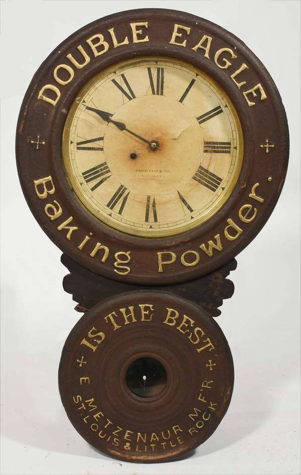 """""""Double Eagle Baking Powder - Is The Best, E. Metzemaur Mf'r, St. Louis & Little Rock"""" Made by The Baird Clock Co, Plattsburgh, NY. 30.5""""H. -Condition: lettering appears to be re highlighted, screw hole in lower door, surface abrasions, lifting and staining on paper dial, glued chip in waist section, some shrinkage/splitting"""
