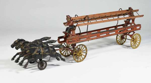 """American late 19th / E. 20th C fire ladder wagon horse drawn pull toy with original paint, team of three black horses pulling ladder wagon with two figures, 26"""" L X 7"""" H X 3.5"""" W. -Condition: broken eyelet and other cast iron where reins would attached to rigging, some paint loss, missing reins"""