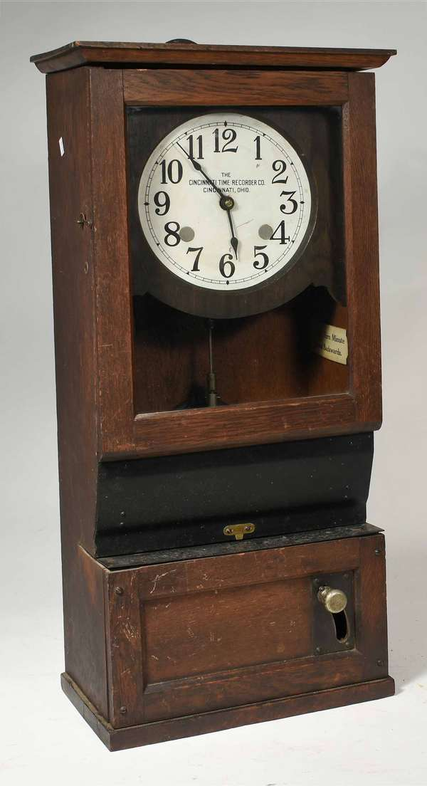 """The Cincinnati Time Recorder Co., Cincinnati, OH oak case time clock, 30.25"""" H  -Condition:  surface abrasions, has not been tested, loose metal plaque at waist"""