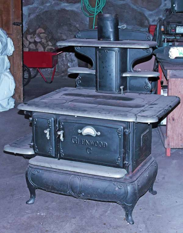 """Antique cast iron Glenwood """"C""""  wood fire cook stove with griddle  -Condition: appears to be in good cosmetic condition, moved from storage"""