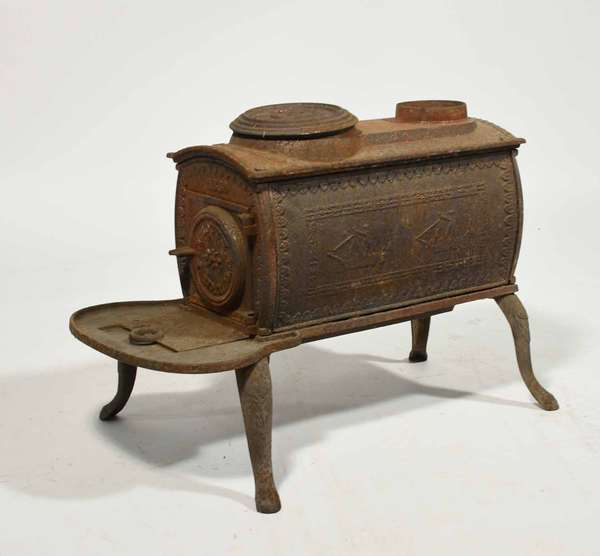 """Small Tyson parlor stove, made in Plymouth VT 1839 No 7, each side depicts ships, 18:H x 24""""L x 13""""W. -Condition very good no cracks"""