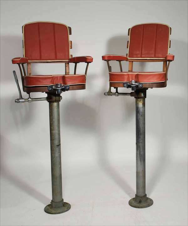 """Pair of vintage fish fighting chairs, with long steel stems likely would have been mounted safely below deck, steel and mahogany frame work with chrome gimble rod holders with both the original cushions and new cushions, 66""""H x 20""""W. -Condition seems good for these vintage chairs"""