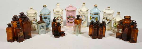 """31 assorted glass and porcelain apothecary jars, many with labels and names, 4.5"""" - 11.5"""" H -Condition: some with minor chipping, missing labels, etc - see images"""