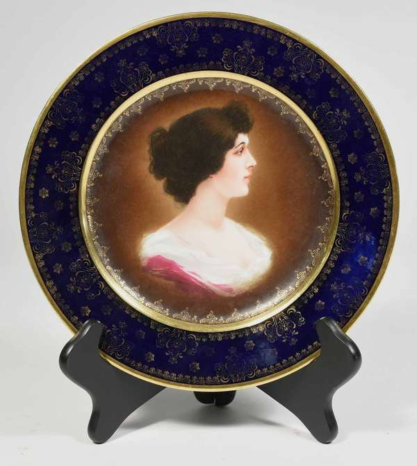 """Royal Vienna cabinet plate with hand painted portrait of young woman, 9.75"""" dia with blue underglaze beehive mark. -Condition: some gilt wear and in an uncleaned state"""