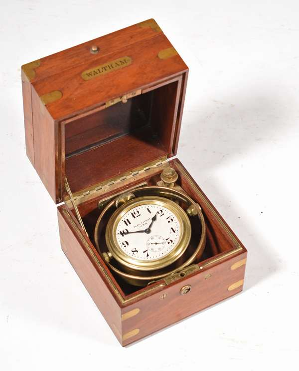 """Fine Waltham gimbal mounted Deck Watch clock in original brass bound mahogany case, running order, 5"""" X 5"""" X 5"""". -Condition: clean original condition, no key for case"""