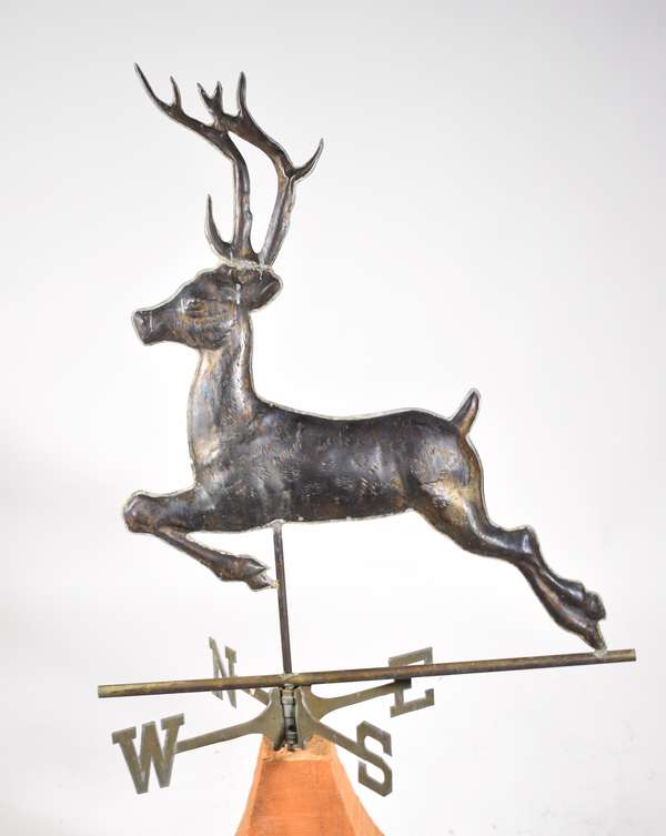 """20th C. copper weathervane, full body leaping reindeer with directional, 32"""" H X 26"""" L. -Condition: minor bending and surface abrasions crack in soldering at attachment to post (stable)"""