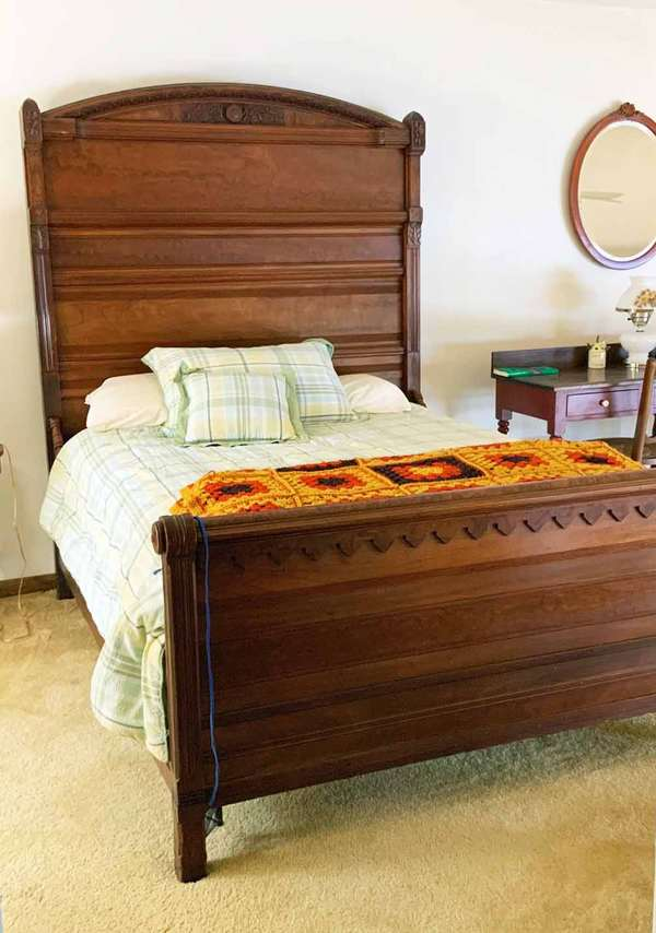 """Full size high back Victorian bed, East lake in style with relief floral carved head board in figured walnut, 74""""H x 60"""", with clean spring and mattress if buyer wants, -Condition very good"""
