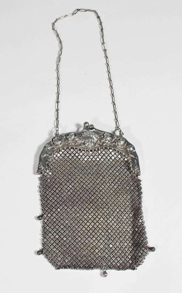 """Sterling mesh ladies purse with finely executed repousse clasp, hallmarked on interior, 6.5""""H. (Purse without chain) 6.9 ozt -Condition: good condition"""