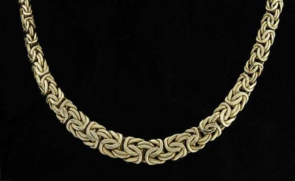 14kt yellow gold flattened tapered byzantine design chain necklace, tapers from 7-10.5 mm wide and is 17 1/2 in. long, 23.3 grams. Condition: fair, preowned, expect signs of normal use.