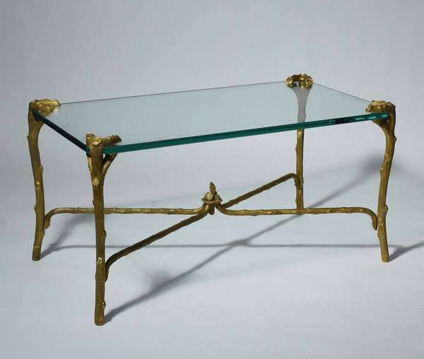 "E. Guerin gilt bronze coffee table, rectangular plate glass top and gilt bronze stretcher base, signed on bottom of foot E. Guerin New York, 18""H x 36""L x 20""D.  Condition: good."