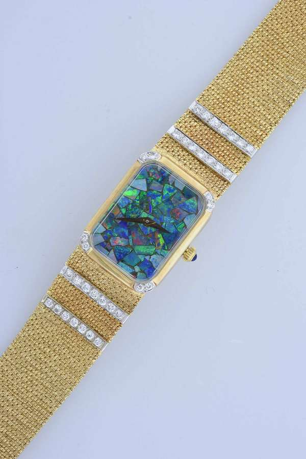 14k yellow gold and diamond ladies wrist watch, rectangular shaped dial with opal stones, mesh style band set with diamonds approx. 7'L, 39 grams.  Condition good, working