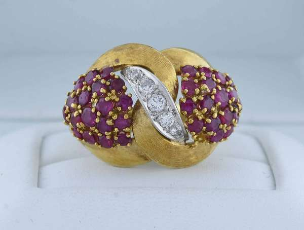 18kt yellow gold cluster ring set w/ approx. 1.25 ct. tw. round rubies accented by approx. .15 ct. tw., set in platinum round brilliant cut diamonds (G-H-VS), sz 7 1/2, 11.1 grams.  Condition: good, preowned expect signs of normal wear.
