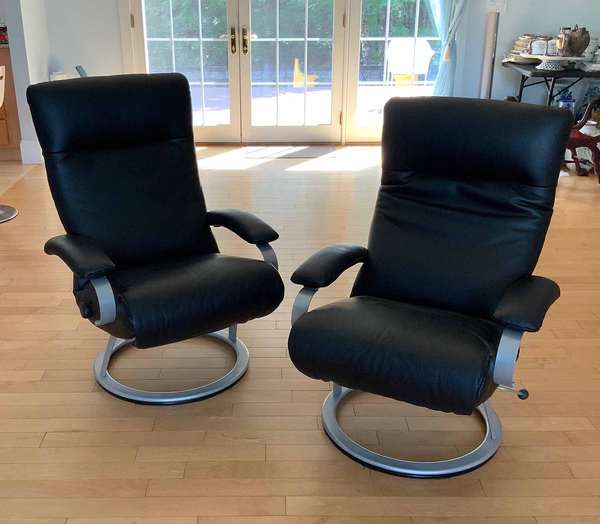 "Percival Lafer (Brazillian, B. 1936). Pair of 'Kiri' Recliner Swivel Chairs, 21st C. Black leather 42""H x 30""W, seat height 18"".  Condition: In overall very fine condition with no issues detected."