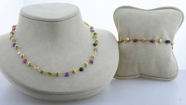 Signed Marco Bicego 18kt yellow gold matching necklace and bracelet set with multi-color natural gemstones including, amethyst, tourmaline and iolite, among others, N= 16 in. long, B= 7 in. long, 15.7 grams.  Condition: very good, preowned, expect signs of normal wear.
