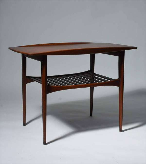 "Tove and Edvard Kindt-Larsen (Danish, 1906 - 1994, 1901 - 1982). Two-Tiered Teak End Table, 1960s. Manufactured by France & Daverkosen. The underside with stamped manufacturer's mark [FD Made in Denmark] and applied distributor's label [John Stuart Inc Grand Rapids New York]. 30"" X 20"" X 22"" H.  Condition: In overall very fine condition. Two small 1/4"" circular stains on top near edge. Minimal light scuffing to the ends of the legs, commensurate with age and use."