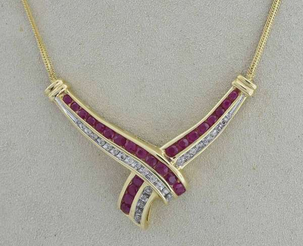 14kt yellow gold ruby and diamond necklace set with approx. 1.25 ct. tw. slightly purplish red, moderately-heavily included rubies accented by approx. .50 ct. tw. round brilliant cut diamonds (J-K-I1), 17 in long,  8.1 grams.  Condition: good, expect signs of normal wear.